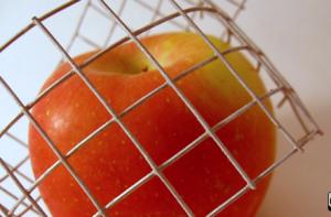 caged apple